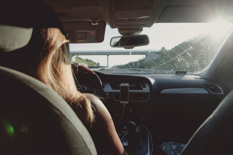 woman-driving-car-on-freeway-1386648